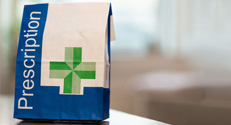 Close up shot of a paper prescription bag